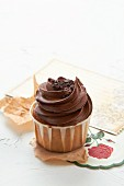 Chocolate Cupcake with Chocolate Frosting and Sprinkles