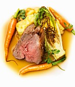 Lamb with roasted lettuce, carrots and mashed potatoes