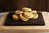 Lemon sandwich biscuits on a chopping board