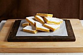 Lemon bars dusted with icing sugar