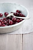 Fresh cranberries in a bowl with a spoon