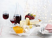 A cheese platter with wine