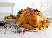 Roast turkey with bacon and oranges for Christmas