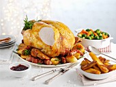 Roast turkey, slices, with sides for Christmas dinner