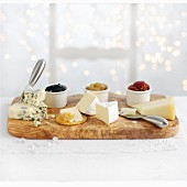 A cheese platter with various preserves for Christmas
