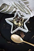 Festive ice-cream dessert decorated with chocolate sprinkles