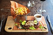 Steak with Peppercorns and French Fries