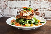 Roast organic chicken on a salad of rocket, cherry tomatoes in balsamic dressing and roast potatoes