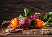 Fresh organic beetroot and golden beets on a chopping board