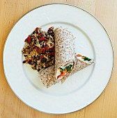 Wraps with couscous, beans and goji berries