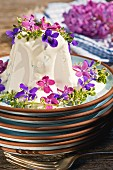 Goat's cream cheese with violets and lilac flowers