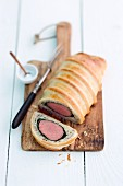 Beef Wellington on a wooden board