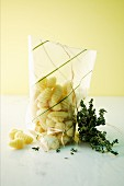 Gnocchi in a plastic bag and fresh thyme