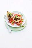 Minced meat tartlets on tomato salad