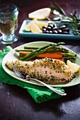 Gratinated salmon fillets with a couscous crust and a side of vegetables
