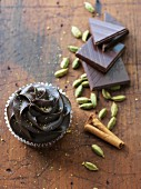 A chocolate cupcake with cardamom and cinnamon