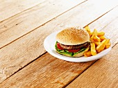 A hamburger with chips on a plate