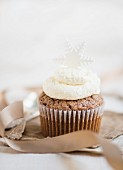 A chocolate cupcake decorated with buttercream and a snowflake (Christmas)