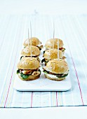 Mini burgers with chicken breast, basil and parsley