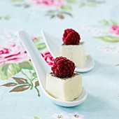 Panna cotta as spoon canapés with raspberries