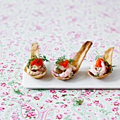 Prawn salad with caviar and dill on baked spoons as spoon canapes