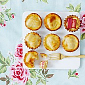 Mini vanilla cream and rhubarb pies