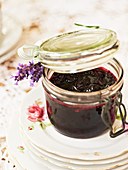 Cherry and lavender chutney in a preserving jar