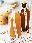 Two bottles of homemade pear syrup
