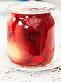 A jar of red wine pears