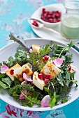 A wild herb salad with Paneer cheese and pomegranate seeds