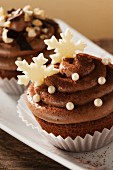Cupcakes topped with chocolate cream for Christmas