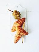 Kiwi jam with vanilla and croissants