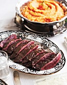 Roast venison with mashed parsnips and carrots for New Year's Eve