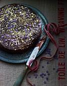 Spiced Christmas chocolate cake on a black plate