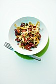 Spicy fried pasta with chorizo, radicchio and seeds