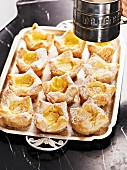 Flaky pastries with vanilla cream and icing sugar
