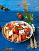 Penne pasta with strawberries, ham and feta cheese