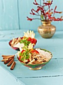 Cinnamon and coconut chicken with peppers and rice (Asia)