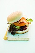 A burger with baked Camembert, cranberries and bacon