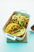 Chicken tacos in a backing dish