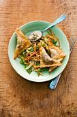 Mushroom wontons with stir-fried vegetables and hijiki seaweed sauce