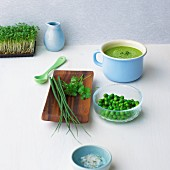 Pea and herb soup with fresh cress