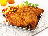 Breaded chicken breast with a tomato and sweetcorn salad