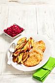 Pork escalope with fried potatoes and beetroot salad