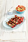 Chicken, onion and pepper skewers with a pasta salad