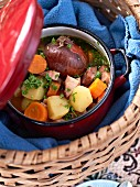 Hearty autumnal soup with pork and vegetables