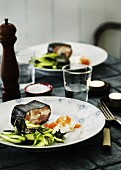 Fish terrine wrapped in a nori leaf with a green asparagus salad, horseradish cream and caviar