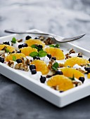 Skyr yoghurt with mandarins, blueberries and walnuts