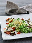 Green risotto with mushrooms, thyme and grated cheese