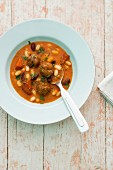 Spicy bean stew with meatballs and chorizo